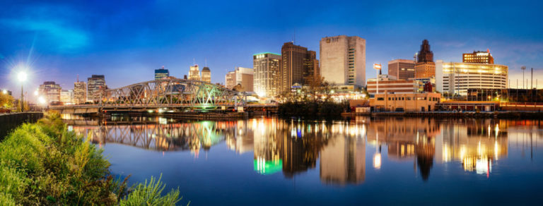 Newark Skyline reflected on Passaic River at dusk. New Jersey. USA.